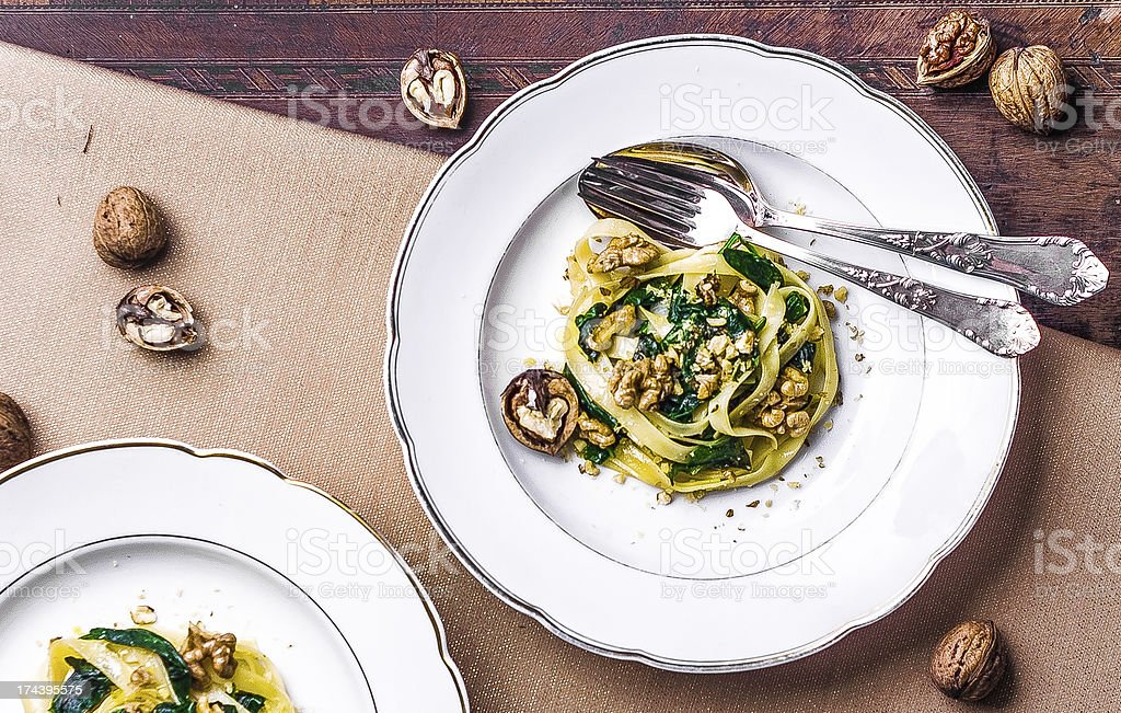 Delicious pasta with walnuts and spinach royalty-free stock photo