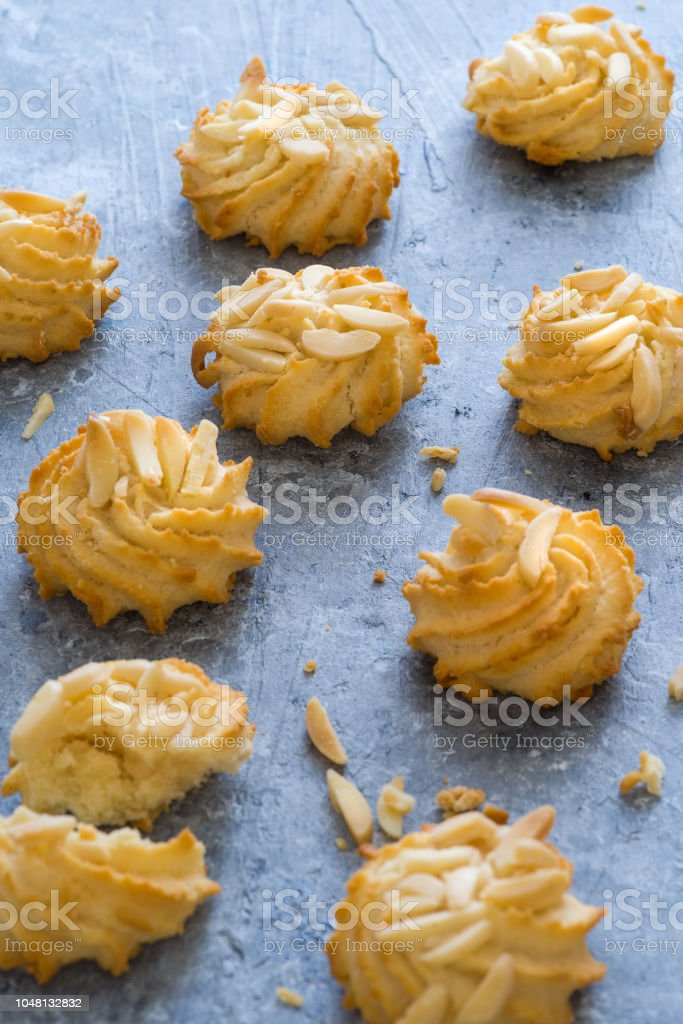 Delicious pastry with almond on blue background - foto stock