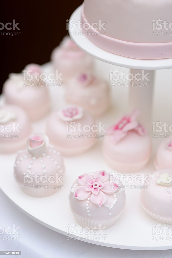 Delicious pink wedding cupcakes stock photo