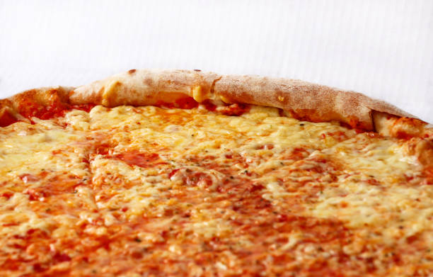 Delicious pizza Margarita. Take out freshly baked italian pizza being held in a box, close up. Italian traditional classic pizza Margarita. Fast Food. Enjoying the great tastes of Italian cuisine. stock photo