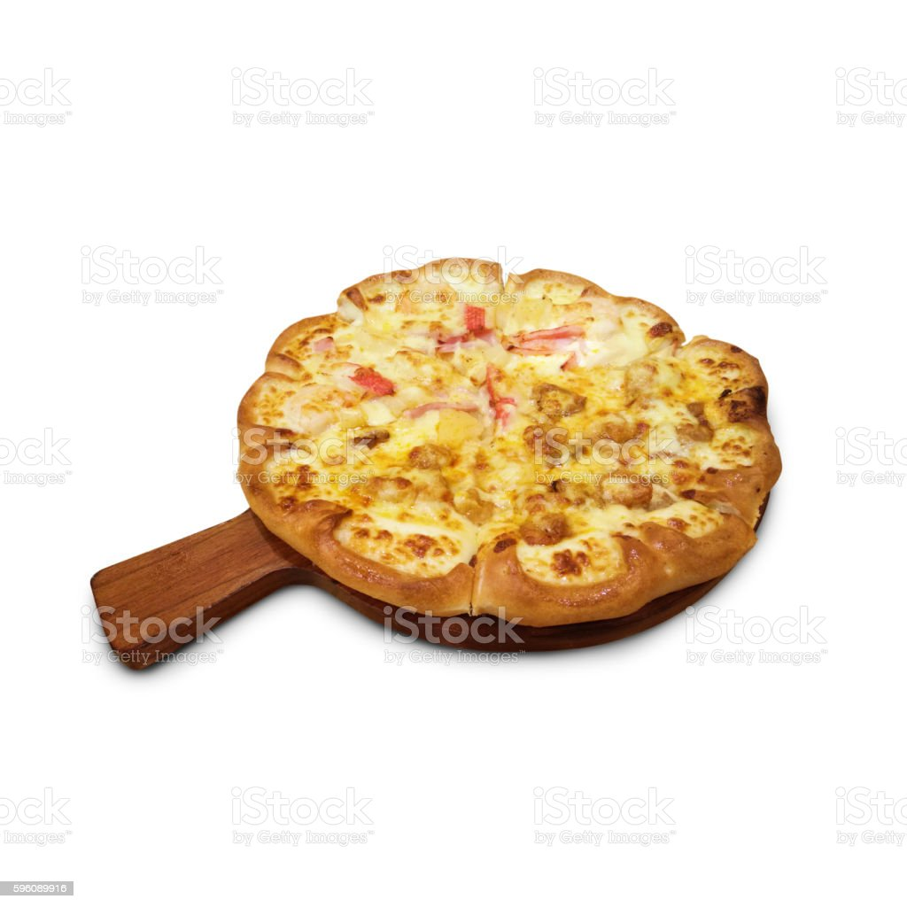 Delicious pizza on wooden round desk isolated white background royalty-free stock photo
