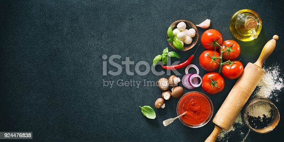 istock Delicious pizza with ingredients and spices 924476838