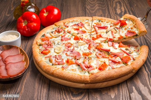 istock Delicious pizza with ingredients 543362650