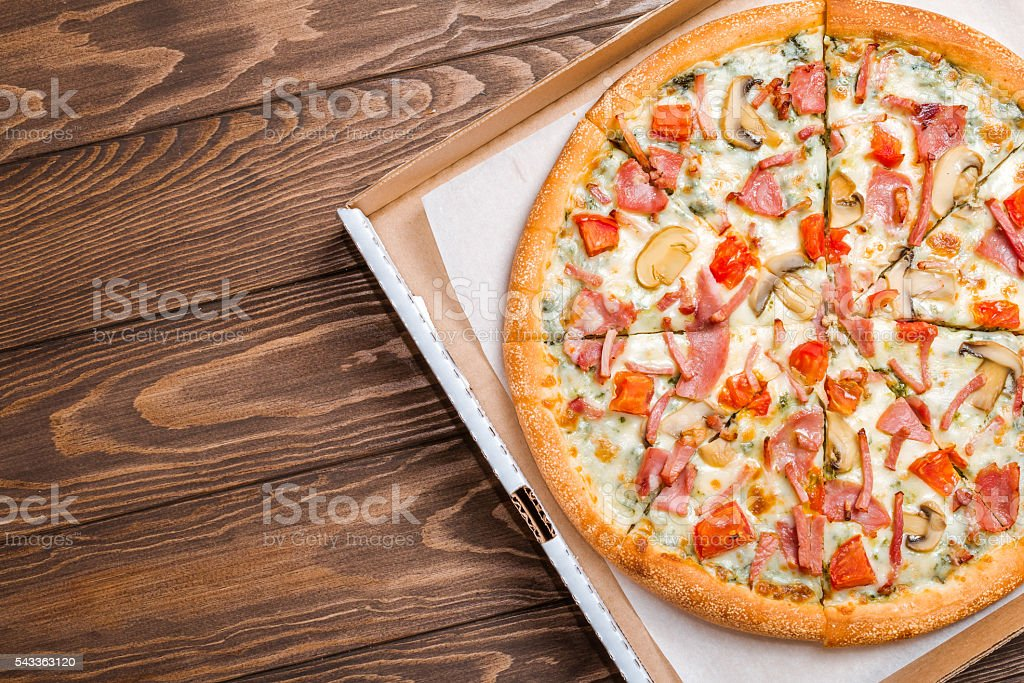 Delicious pizza with mushrooms and ham stock photo