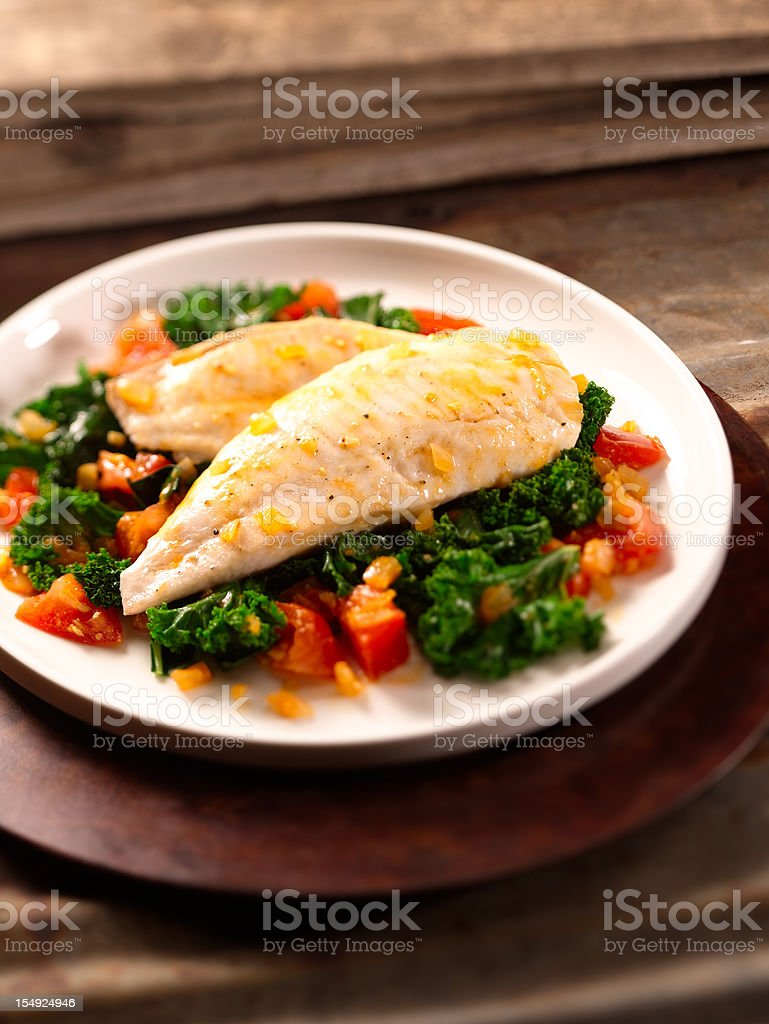 A delicious platter of baked tilapia stock photo