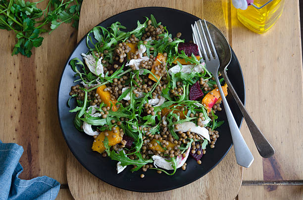A delicious platter of chicken, lentil and squash medley stock photo