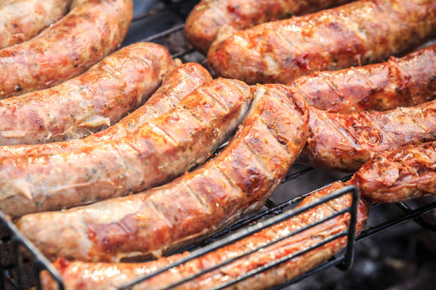 Delicious pork sausages with crispy crust cooked on the grill stock photo
