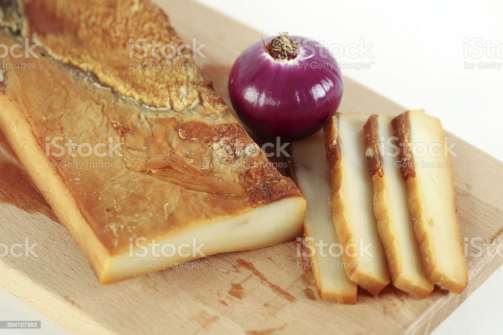 Delicious pork smoked fat with onion on wooden plate stock photo