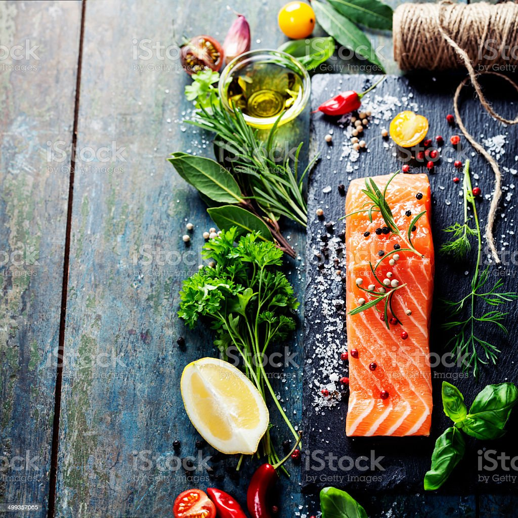 Delicious  portion of  fresh salmon fillet  with aromatic herbs, stock photo