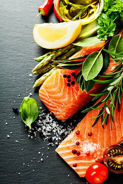 delicious  portion of  fresh salmon fillet  with aromatic herbs, - food and drink stock photos and pictures