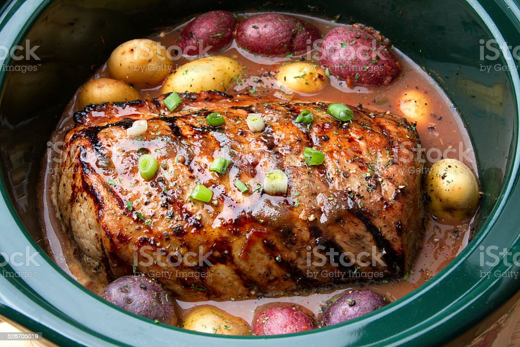 Delicious Pot Roast Dinner in a Crock Pot stock photo