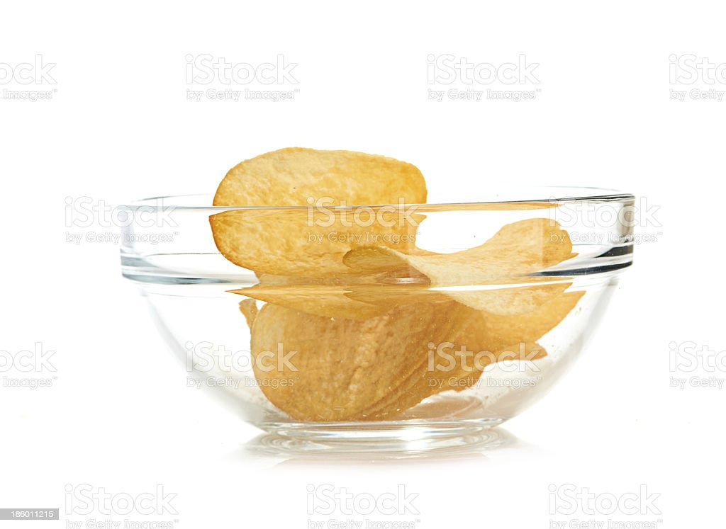 Delicious potato chips in bowl isolated on white royalty-free stock photo