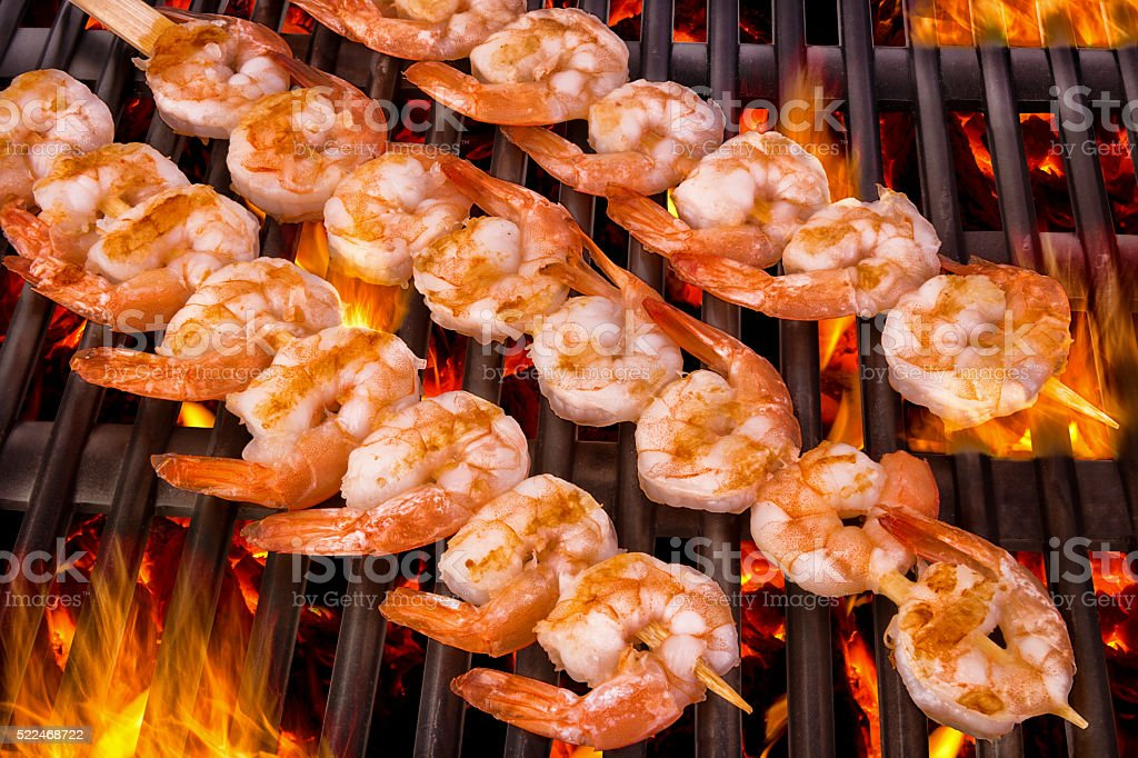 Delicious prawn spit on grill stock photo