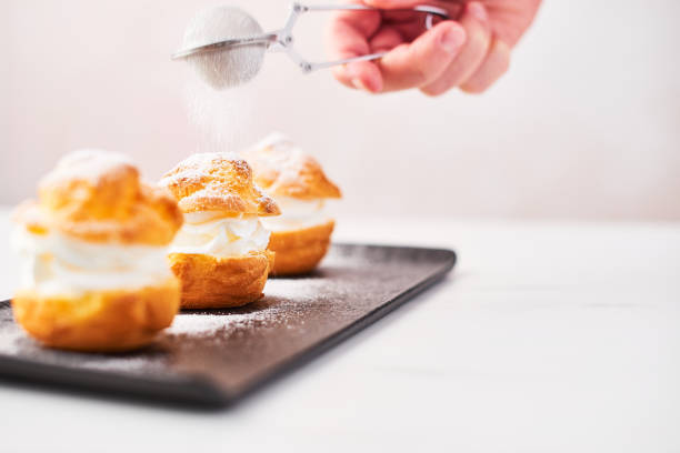 Delicious profiteroles with cream and powdered sugar on a plate picture id1051258852?b=1&k=6&m=1051258852&s=612x612&w=0&h=0mqrvsgyiezv1xbxsuokd0w7rmktax dfb7xhl lonu=