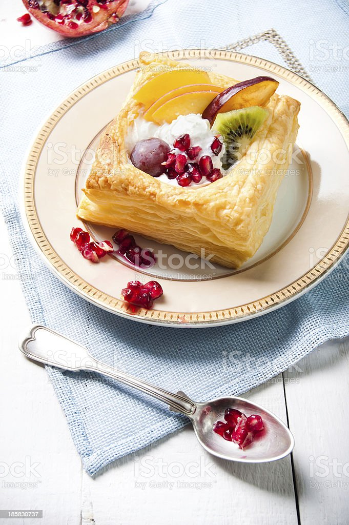 Delicious puff pastry with cream and fruits royalty-free stock photo
