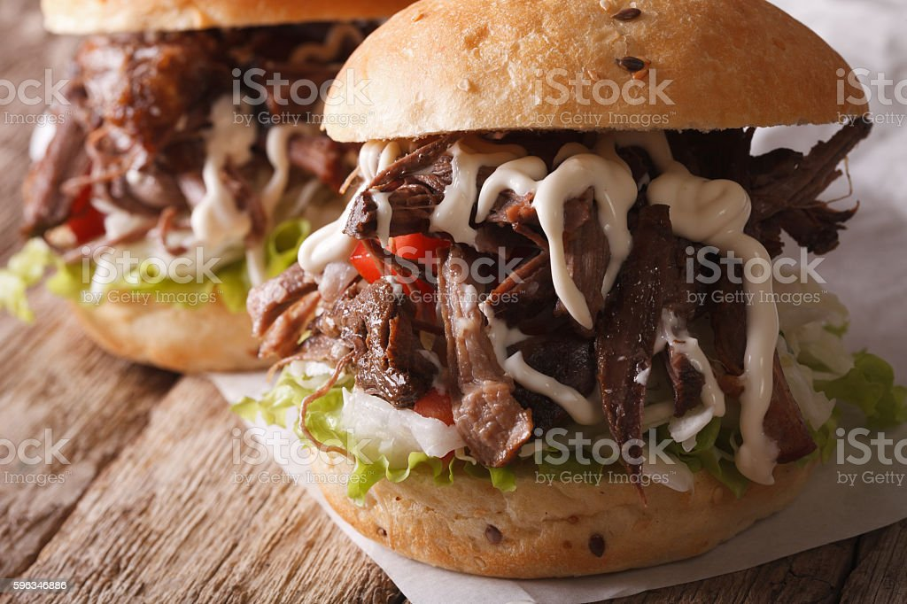 delicious Pulled pork sandwich with slaw and sauce close-up stock photo