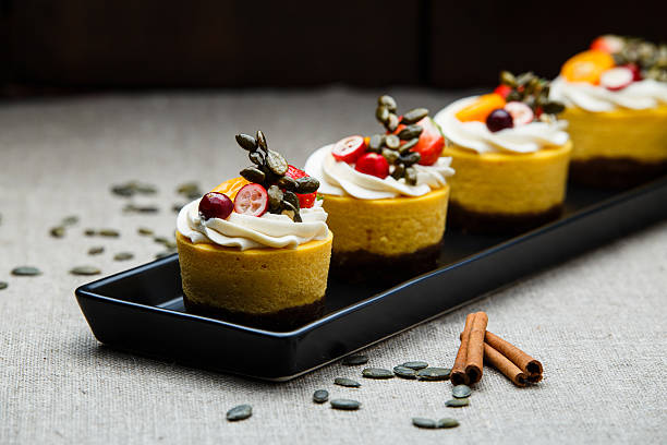 delicious pumpkin cupcakes on black dish. - zitronen quark dessert stock-fotos und bilder