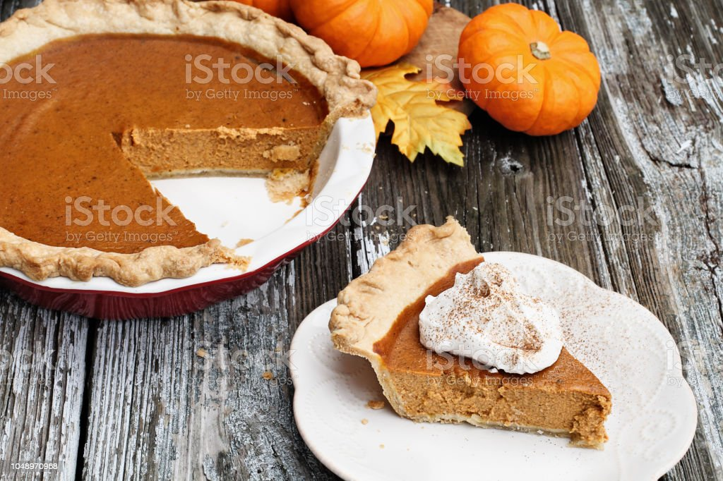 Delicious Pumpkin Pie Slice with Whiiped Cream stock photo