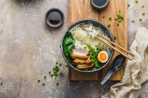 Delicious ramen soup with pork, egg and bok choy, copy space stock photo