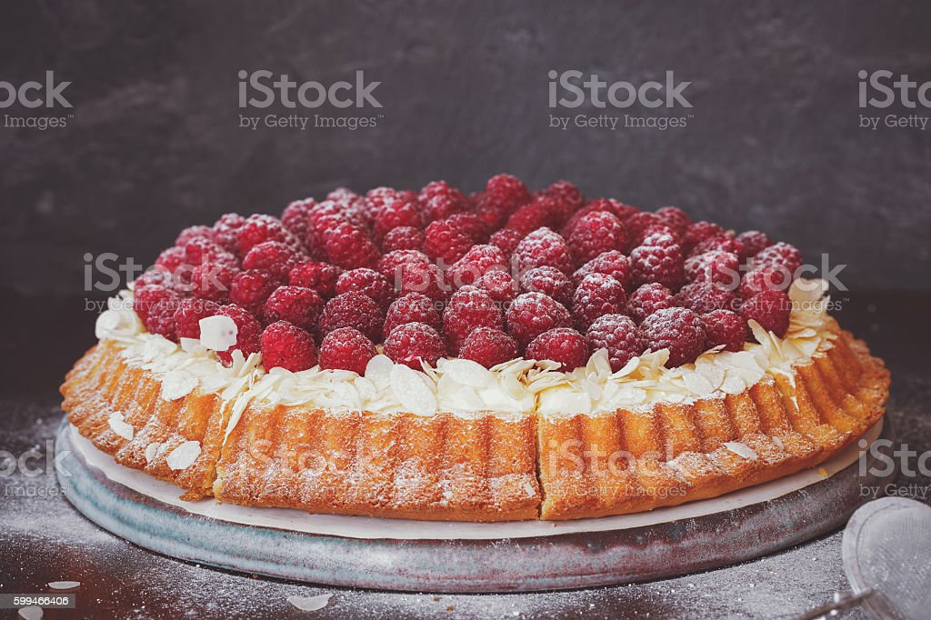 Delicious raspberry tart with fresh raspberries,close up stock photo