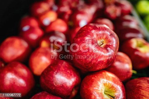 Delicious red apples on retail display at supermarket - No people
