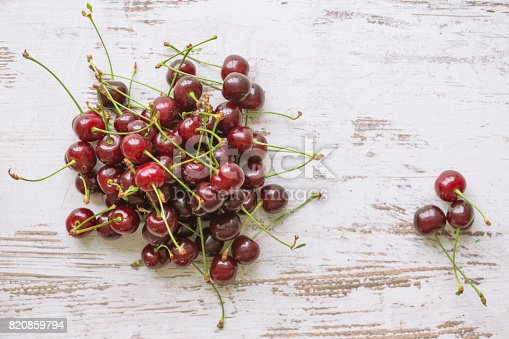 Cherries on wooden table.