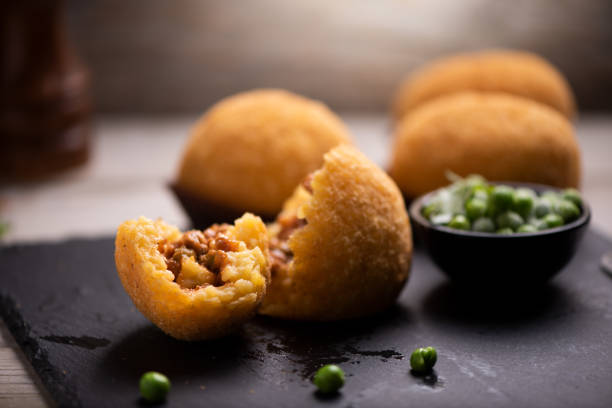 Delicious rice ball on black table stock photo