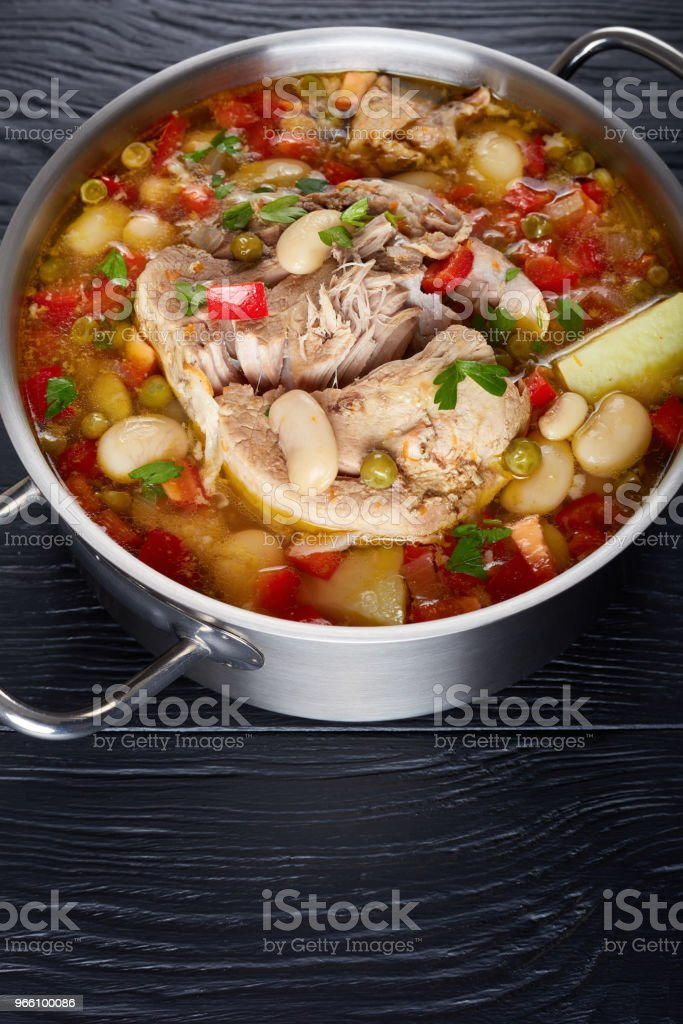 delicious rich pork and vegetables soup with white beans, green peas and species - Royalty-free Acima Foto de stock