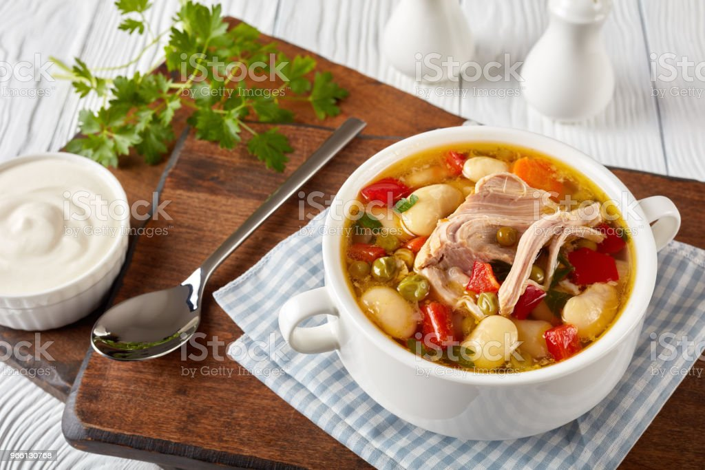 delicious rich pork and vegetables soup with white beans, green peas and species - Royalty-free Above Stock Photo