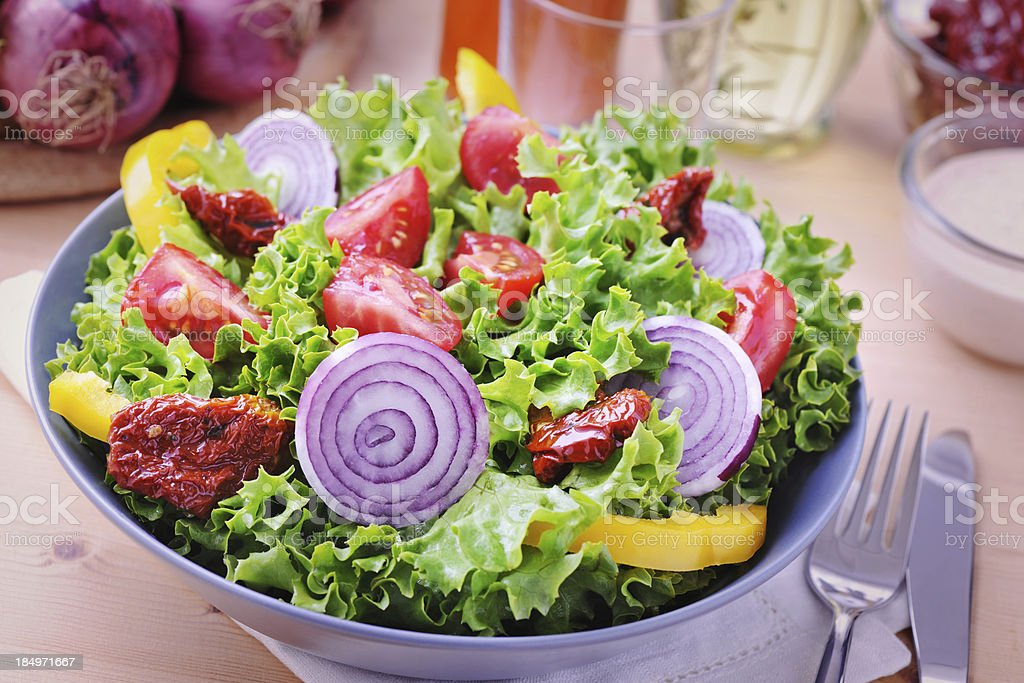 Delicious salad with dried tomatoes royalty-free stock photo