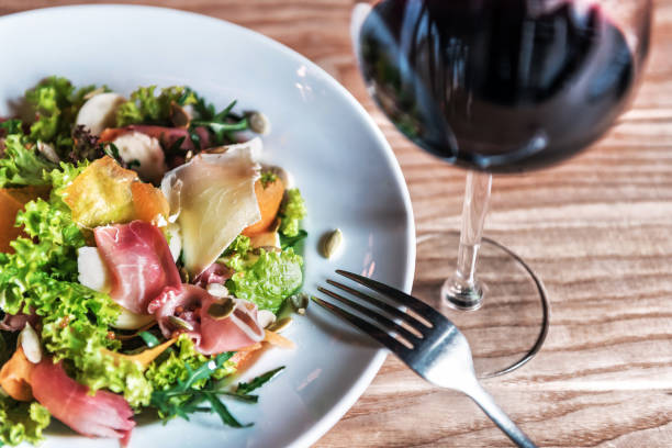 delicious salad with jamon and wine stock photo