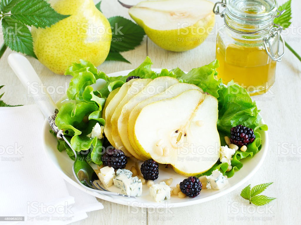 Delicious salad with pears and gorgonzola. stock photo