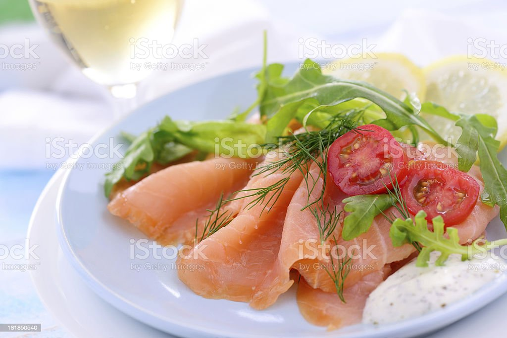 Delicious salad with smoked salmon and white wine stock photo