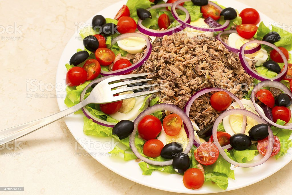 Delicious salad with tuna, tomatoes, eggs, olives and peppers royalty-free stock photo