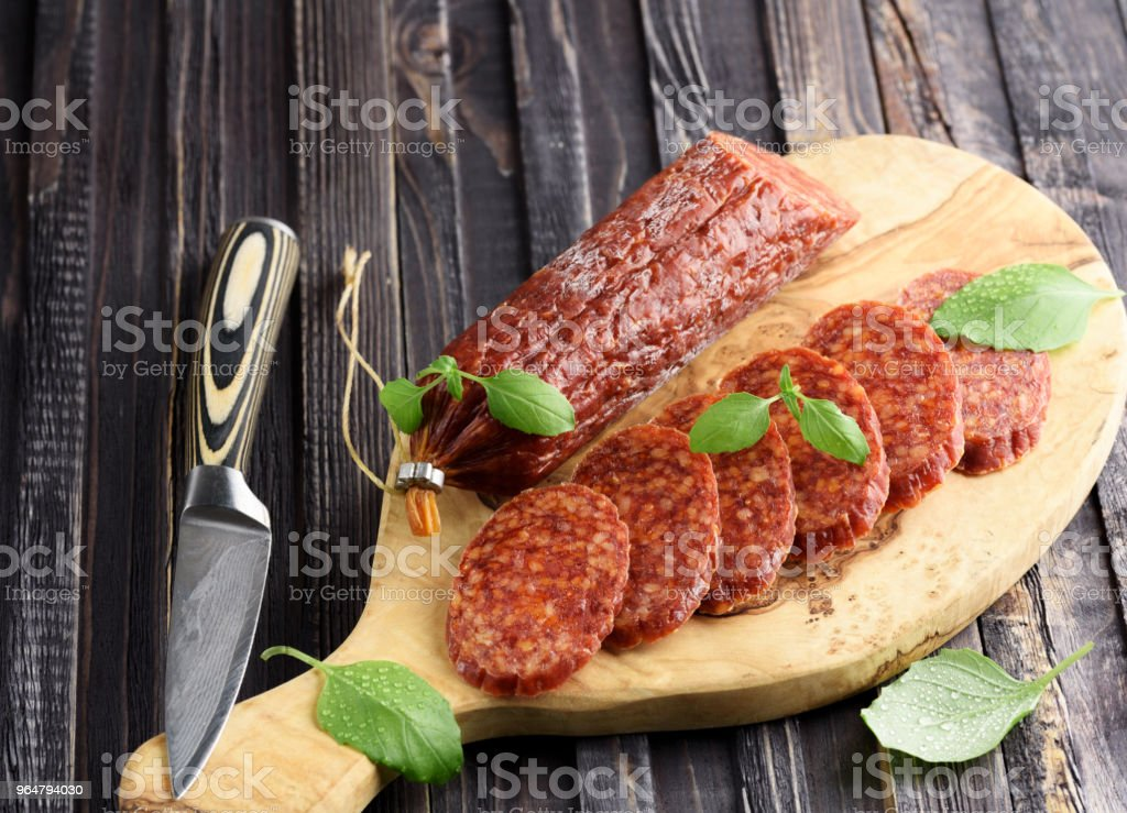 Delicious salami with basil , selective focus royalty-free stock photo