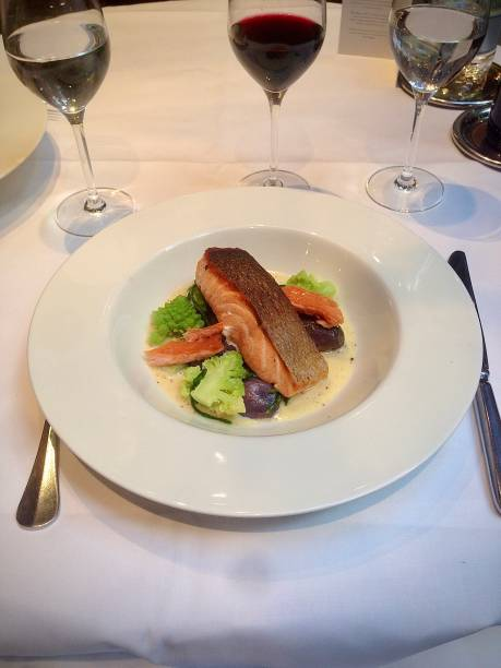 A delicious salmon dish with red wine. stock photo