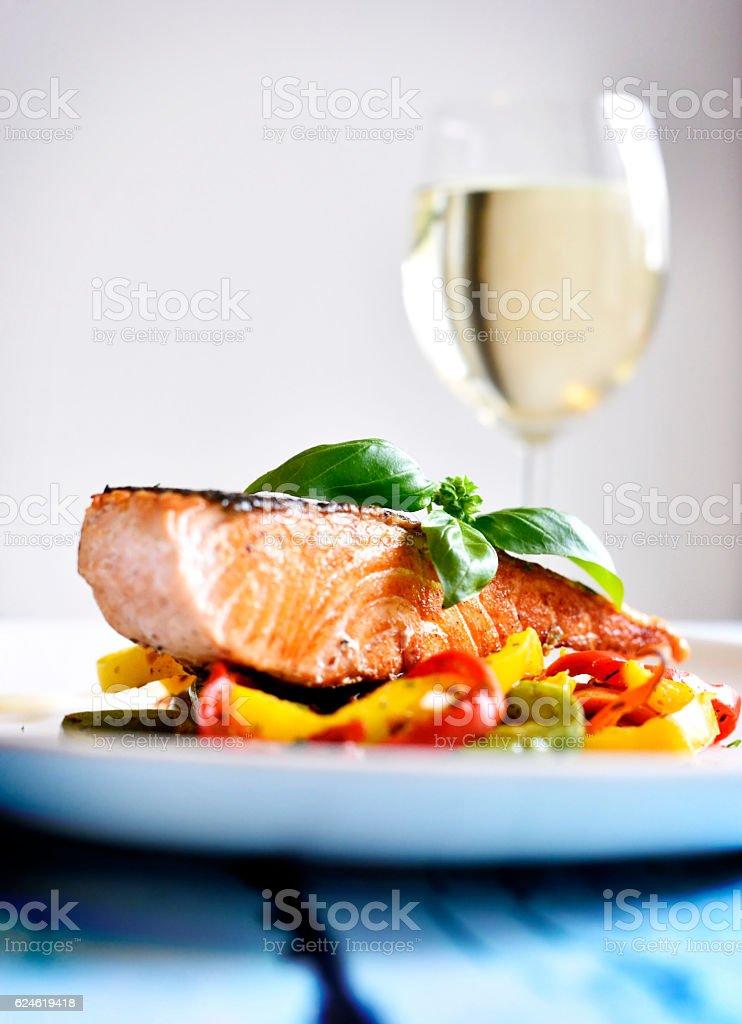 Delicious salmon filet on a white plate stock photo