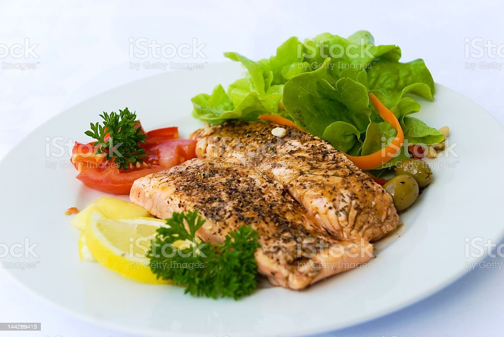 Delicious Salmon-grilled with Crust of Herbs and Butter royalty-free stock photo