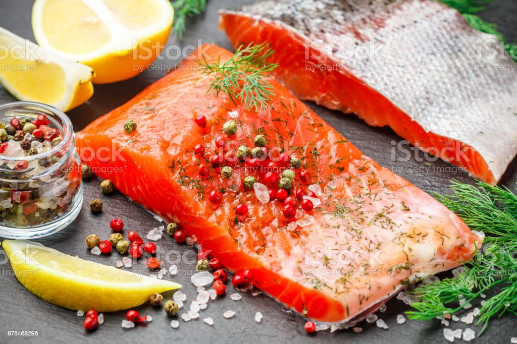 Delicious salted salmon with spices, lemon and dill. Fish. Seafood. Snack for gourmets. Selective focus stock photo