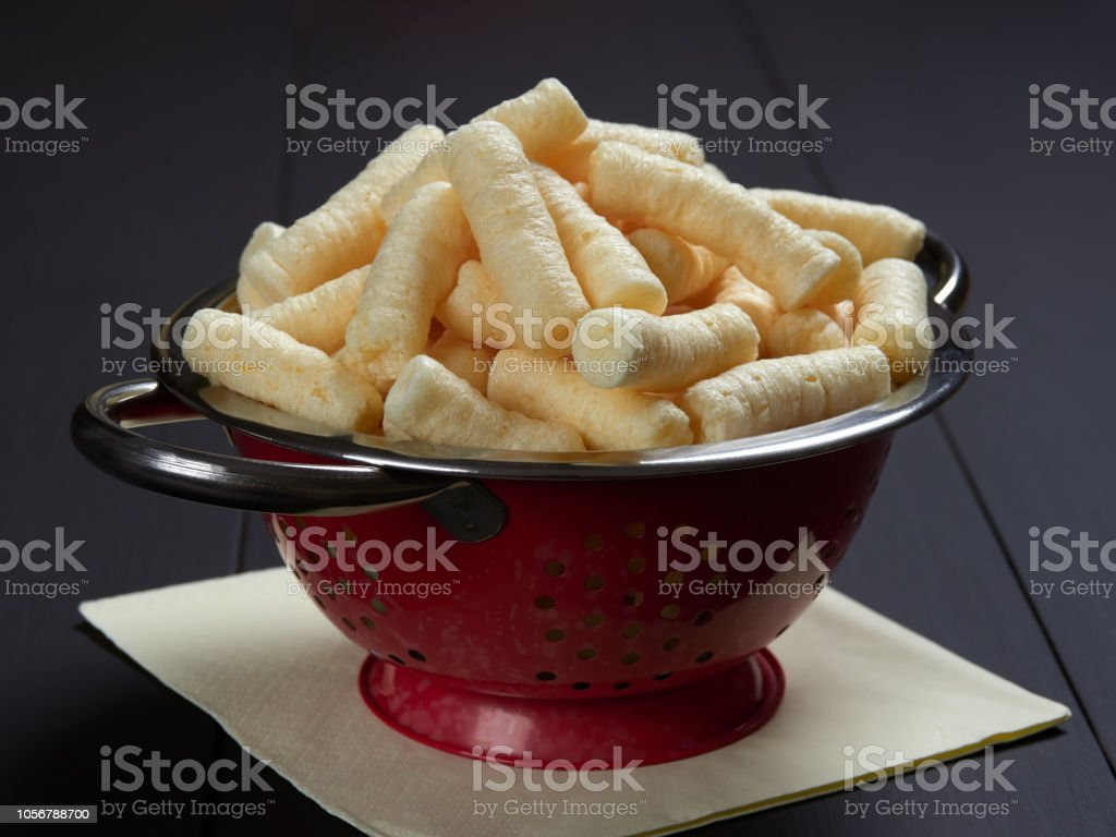 Delicious salty corn puffs snack, also known in Romanian as pufuleti stock photo