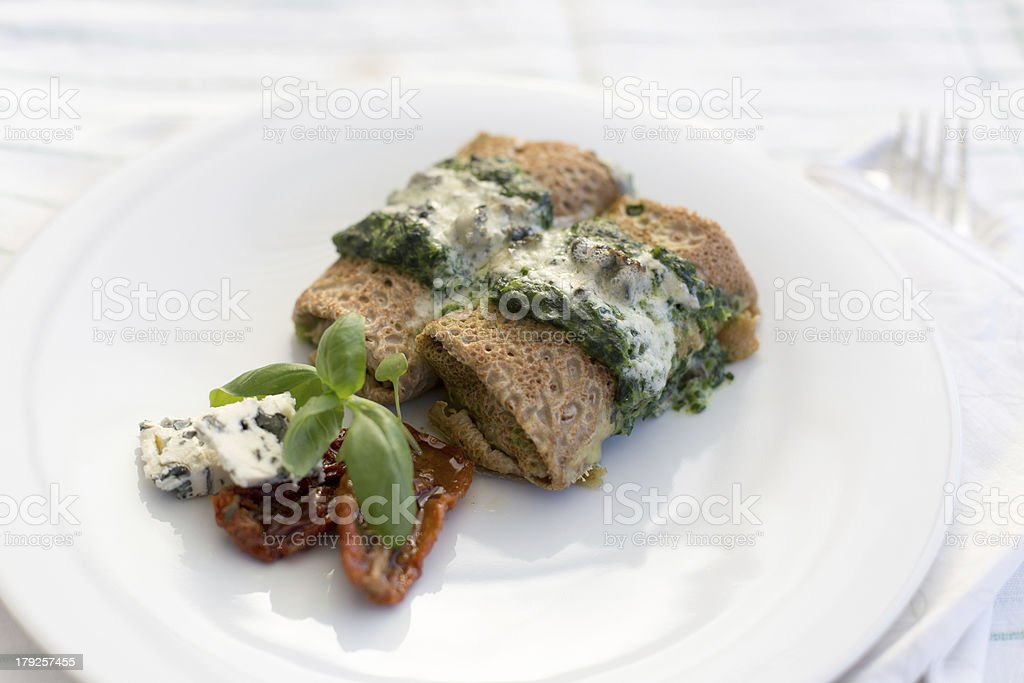 Delicious salty pancakes with spinach royalty-free stock photo