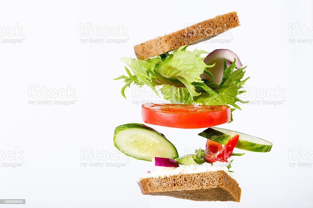 Delicious sandwich ingredients fall between the bread stock photo