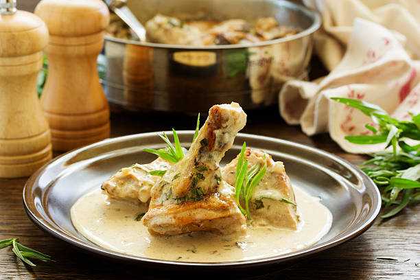 delicious sauteed chicken with tarragon. - tarragon stock photos and pictures