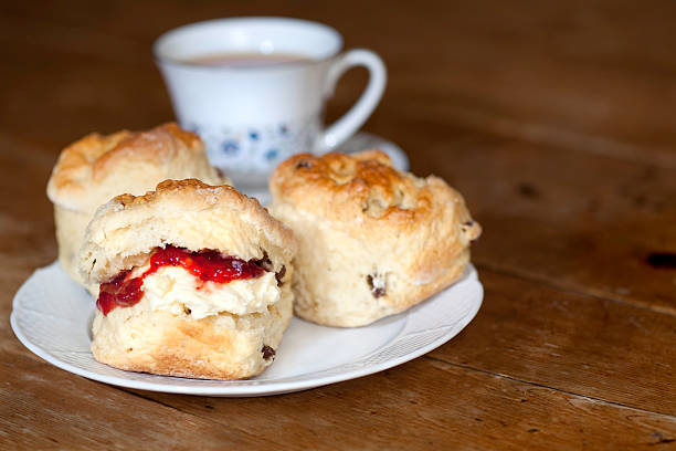 delicious scones, cream and jam on a wooden table - scone bildbanksfoton och bilder