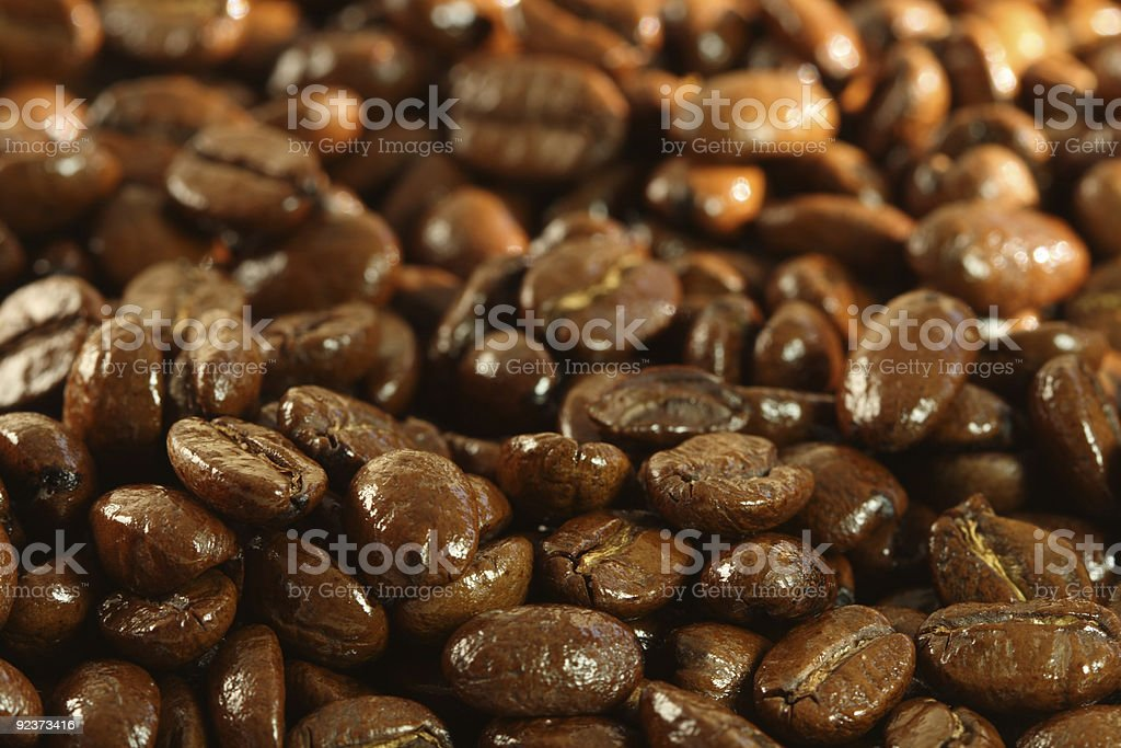delicious shiny freshly roasted coffee beans close-up royalty-free stock photo