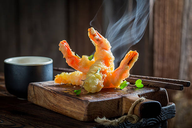 Delicious shrimp in tempura with sweet and sour sauce stock photo