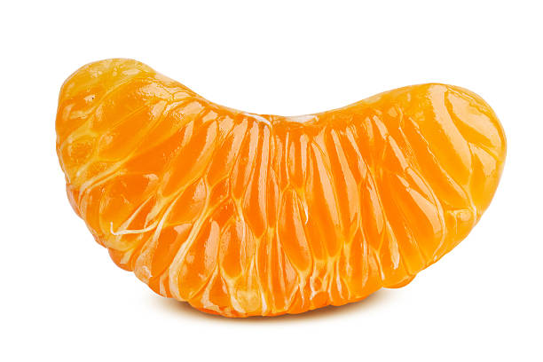 Delicious slice of ripe tangerine Delicious slice of ripe tangerine on a white background tangerine stock pictures, royalty-free photos & images
