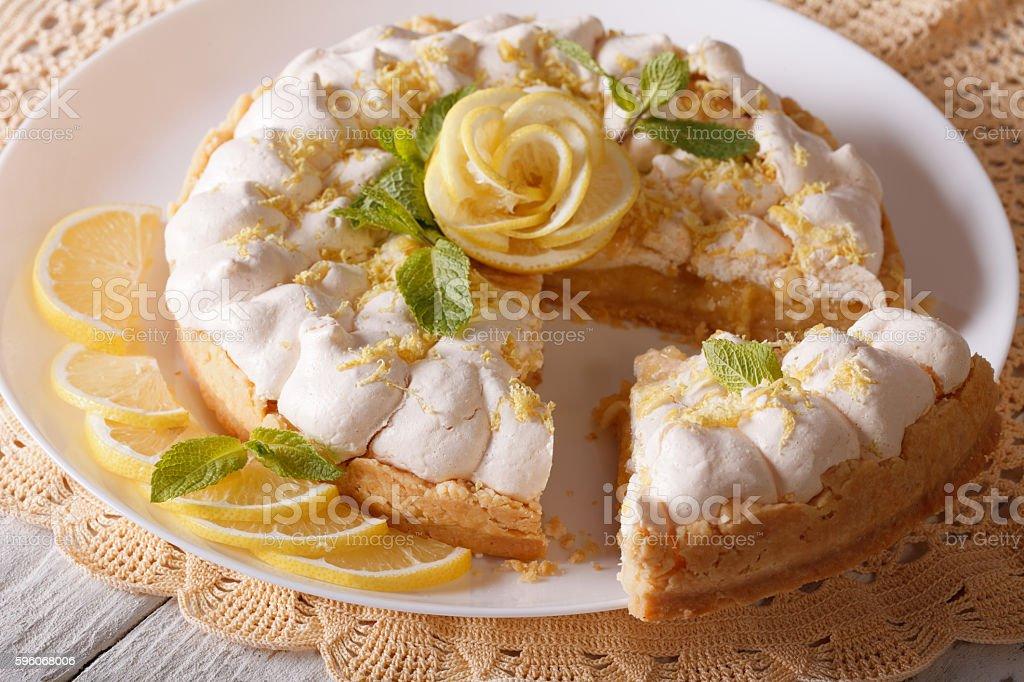 Delicious sliced lemon meringue cake close up. horizontal royalty-free stock photo