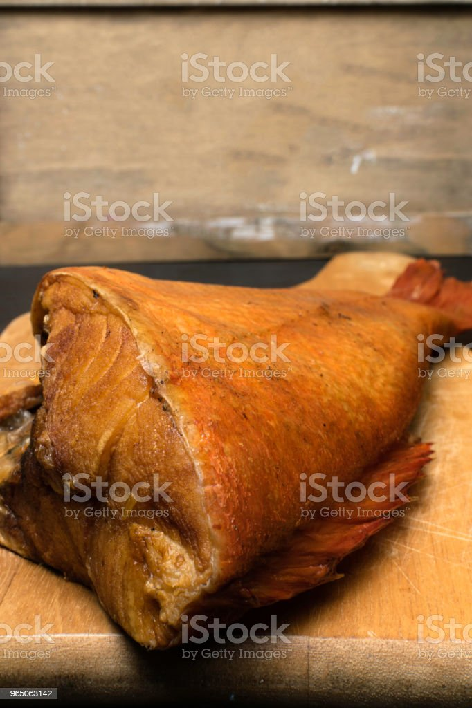 Delicious smoked fish, ocean perch, on wooden background for healthy food, diet or cooking concept, selective focus. Omega 3 zbiór zdjęć royalty-free