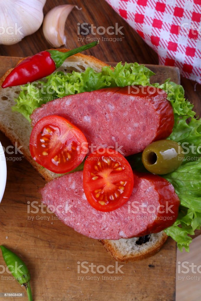 delicious Smoked sausage sandwich on table mat stock photo